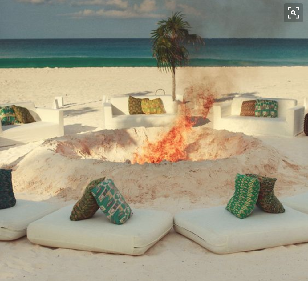 Fire pit with lounge pillows.
