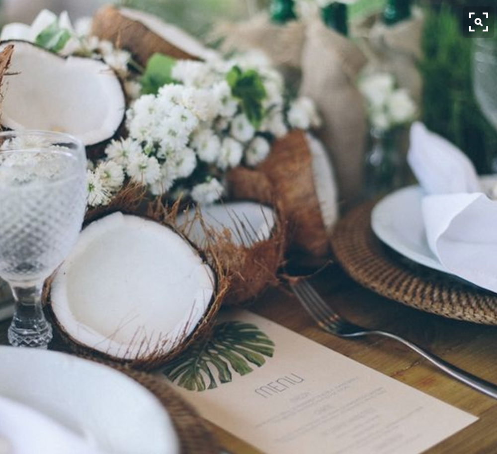 Raw coconuts mixed in with tropical floras.