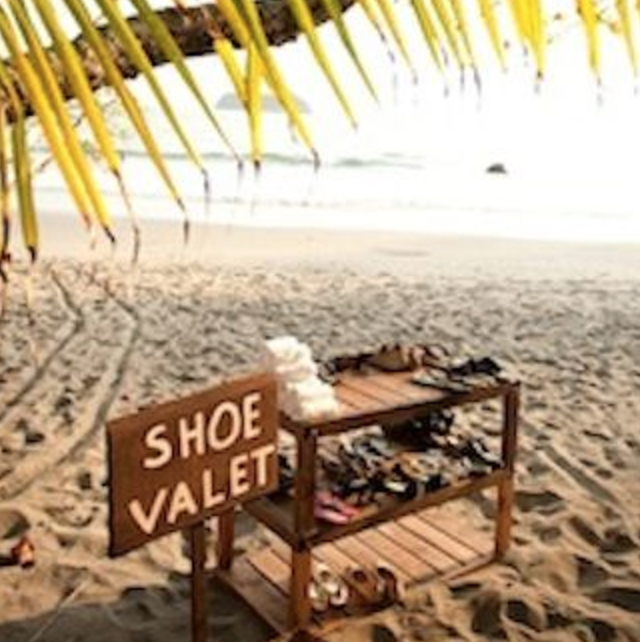 Shoe Valet station but with a mirrored table and modern signage.