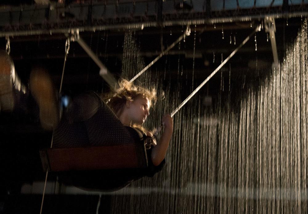 girl on waterfall swing at STRP Biennial Eindhoven