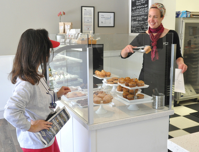 Heather Hardcastle, owner of Flour Craft, right, serves Miriam Kato. (IJ photo/Robert Tong)