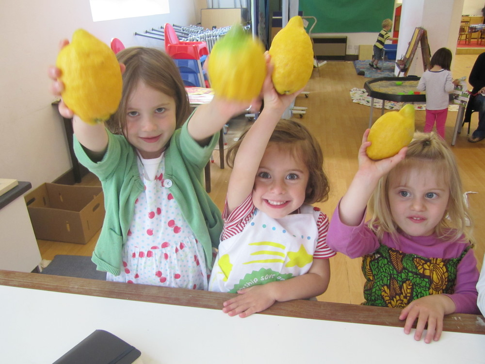 Ivy, Sadie and Iskra with lemons at playschool.