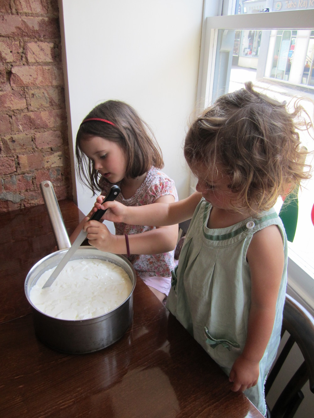 Grace and Ivy making Halloumi at Flinty Red.