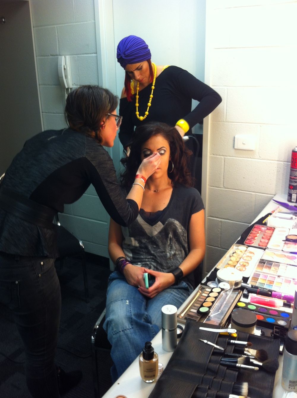 Shula (makeup) and Teresa (hair) working their magic backstage on singer Cindy Alma.