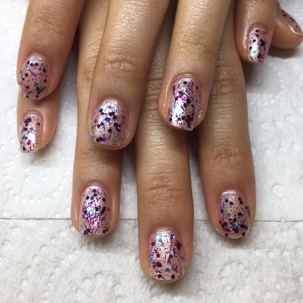 Manicure with glittery polish