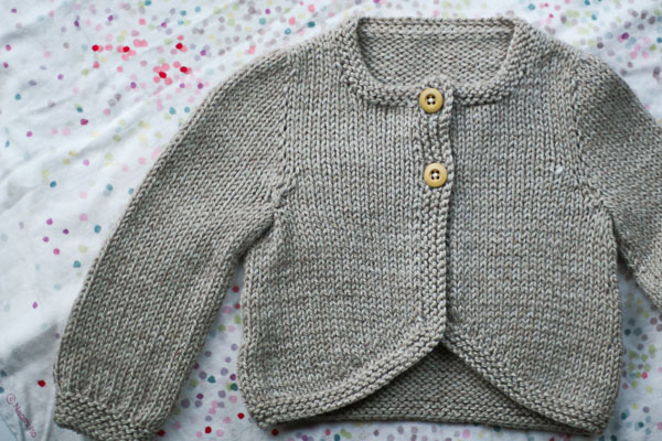 Simple baby cardigan by Gudrun Johnson. Knitted by me in lovely Swan's Island Organic Worsted.