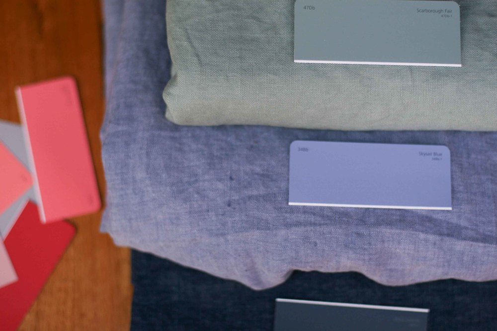 Matching paint swatches to big pieces of pretty linen.