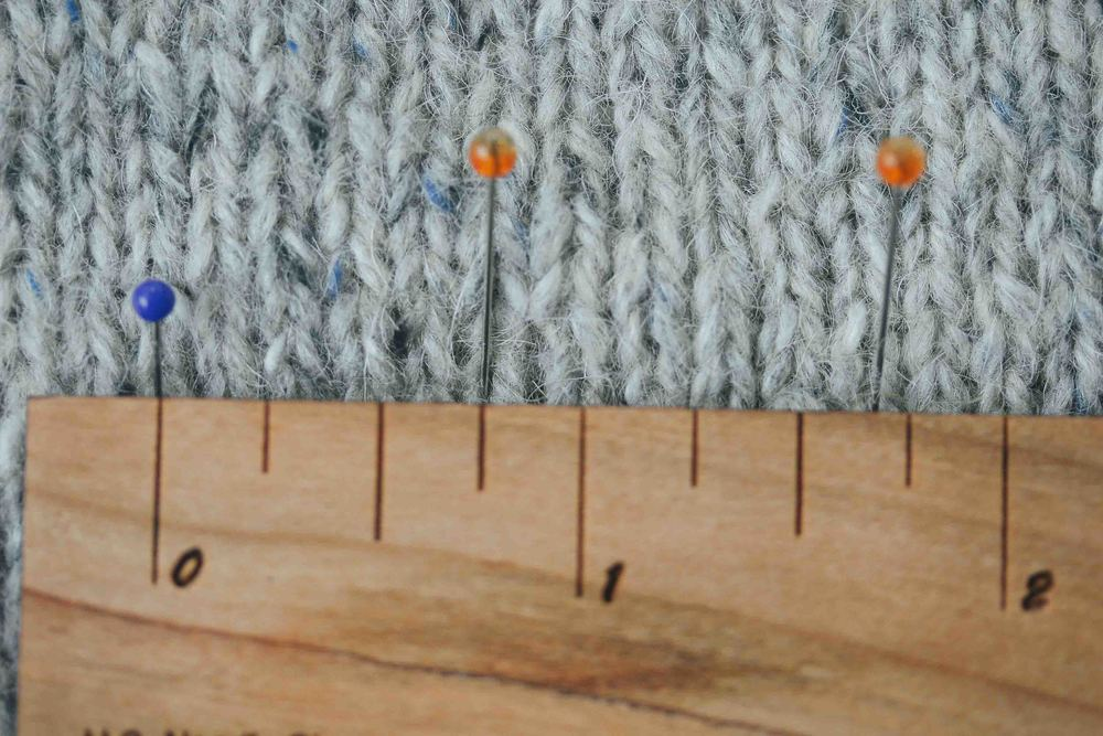 I find it easier to use a different colour pin to mark each 5 stitches. Look for the Vs.