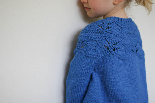 Baby Sibella as a cardy.- photo and knitting by Felicia Semple