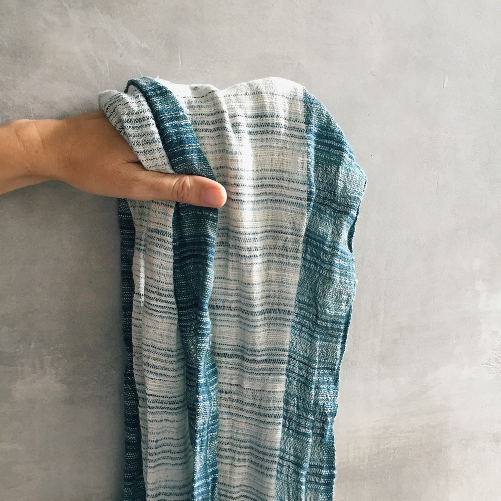From it's tag - This Balinese handspun hand woven shawl is designed by Breeze, a small cottage industry of balinese artists. The natural dyed threads are from plants such as indigo. It is hands-on cotton too.