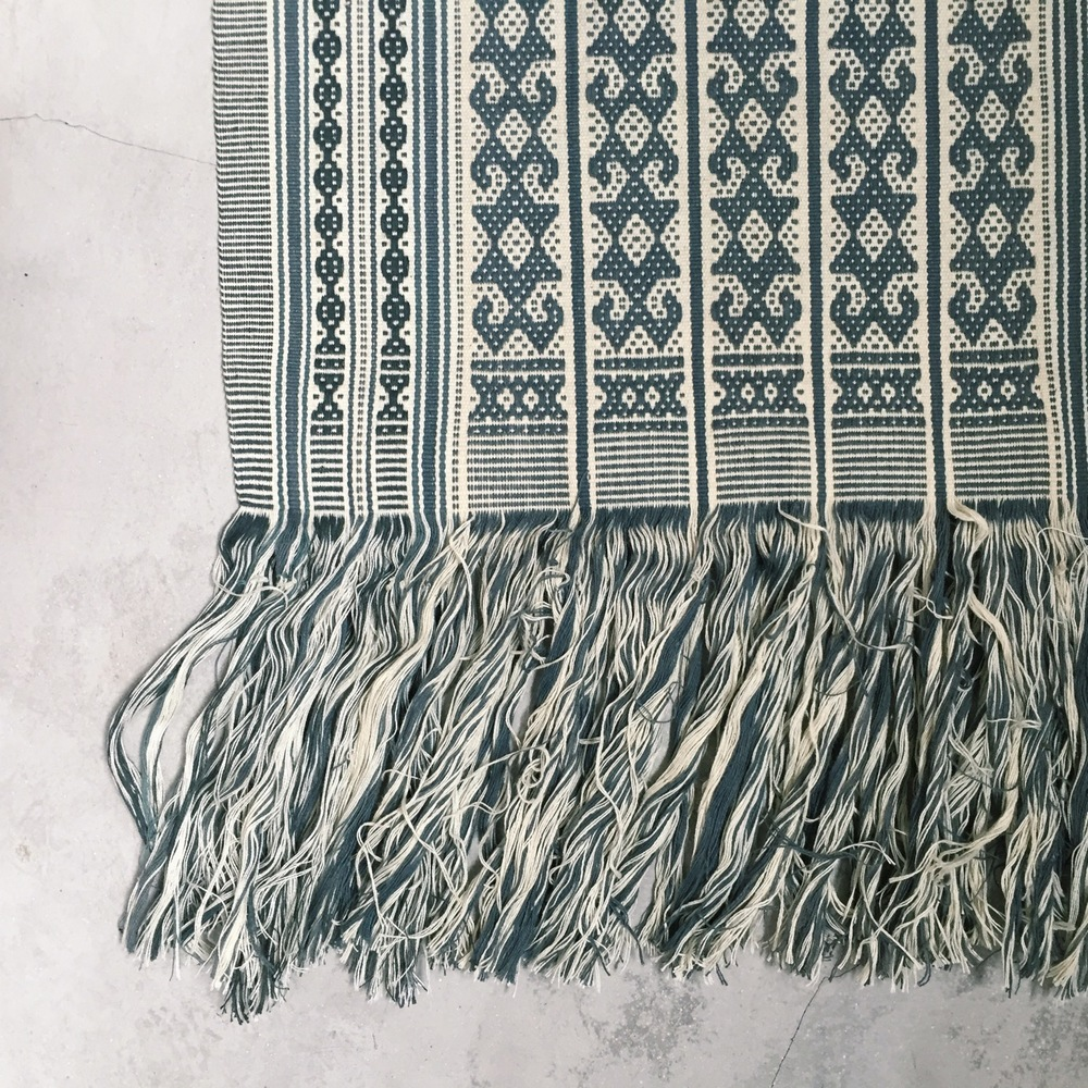 This woman's shoulder cloth called Po'uk Bife is from Baum, Amarasi in the southern part of West Timor. Textiles from this areas share similar designs, and share many of the same motifs.