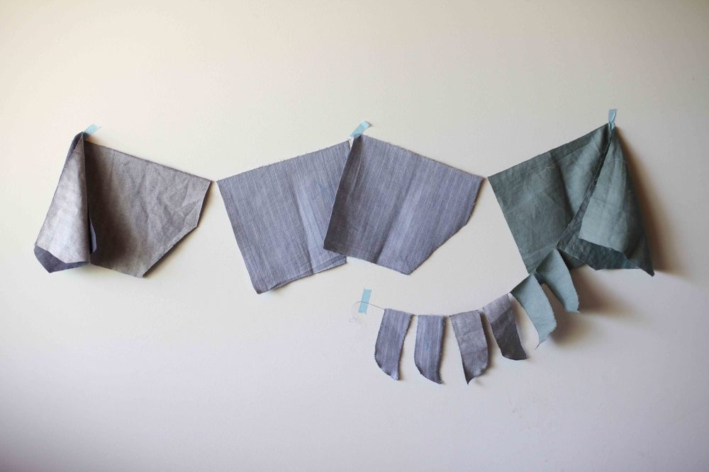 This is six pockets and six fly pieces all chainstitches together using dirty grey cotton for three different pairs of shorts.