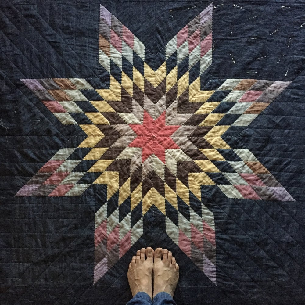 A photo of her quilt.