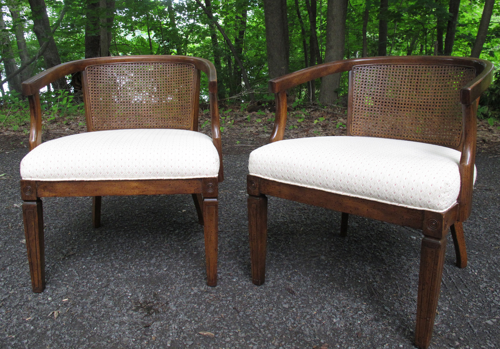 PAIR OF CANE BACK ARMCHAIRS AFTER DUNBAR