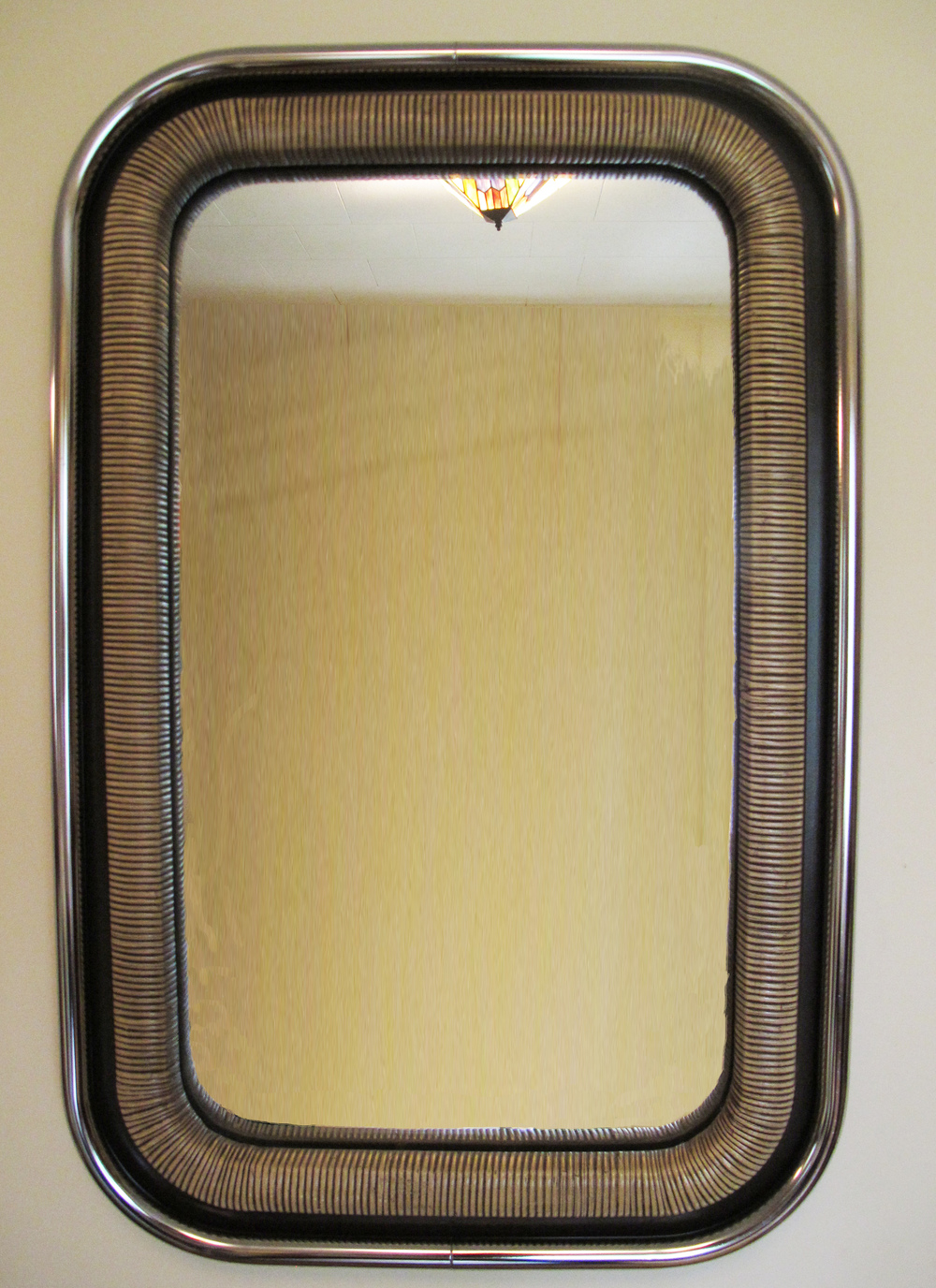 MID CENTURY CHROME AND WICKER OVAL MIRROR BY NUTONE