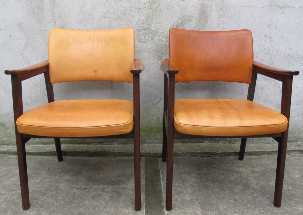 PAIR OF DANISH MODERN ROSEWOOD AND LEATHER ARMCHAIRS