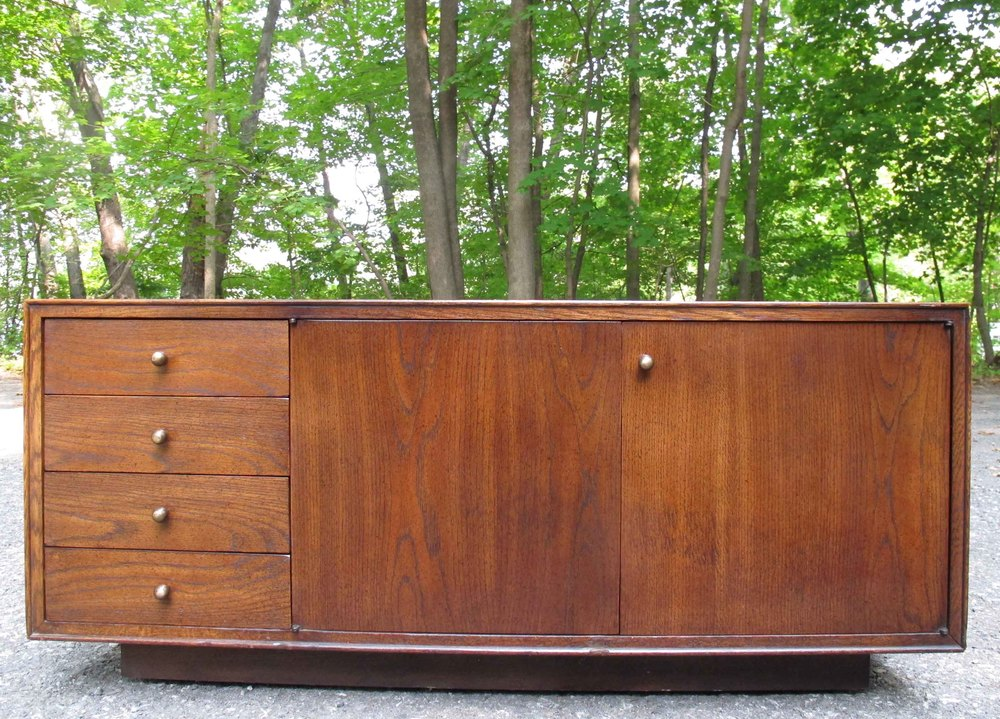 MID CENTURY ROLLING LOW STORAGE CABINET