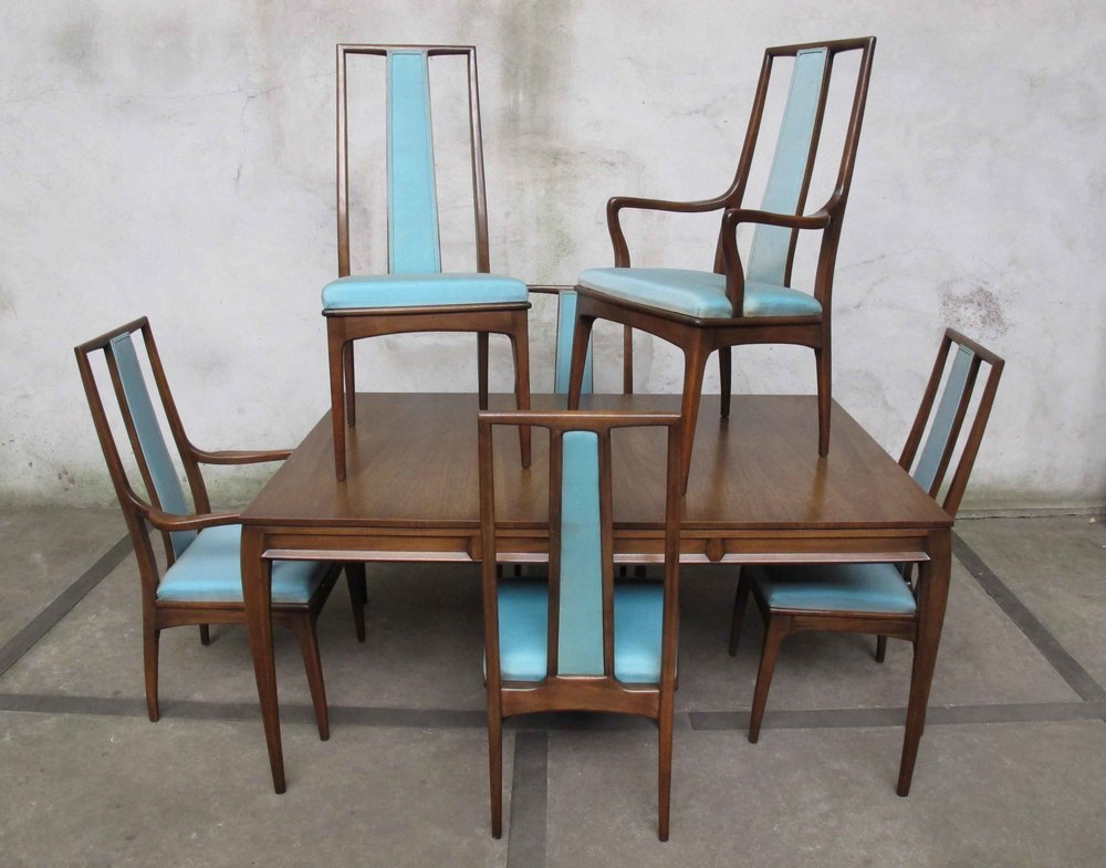 MID CENTURY DINING TABLE AND SIX CHAIRS BY JOHN STUART