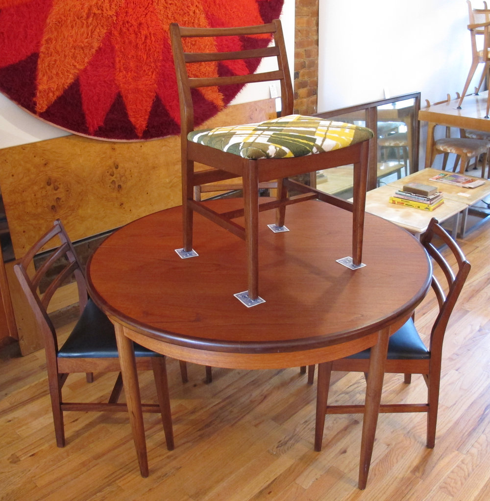 DANISH TEAK DINING SET WITH EXTENSION TABLE AND FOUR CHAIRS