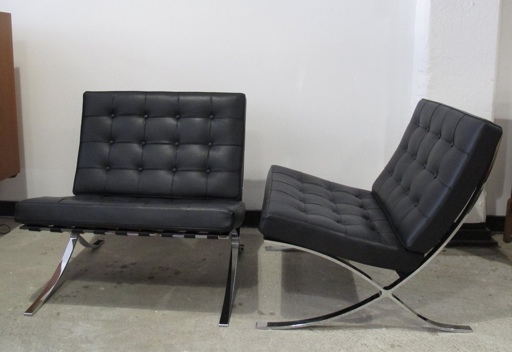PAIR OF BLACK LEATHER MIES VAN DER ROHE BARCELONA CHAIRS