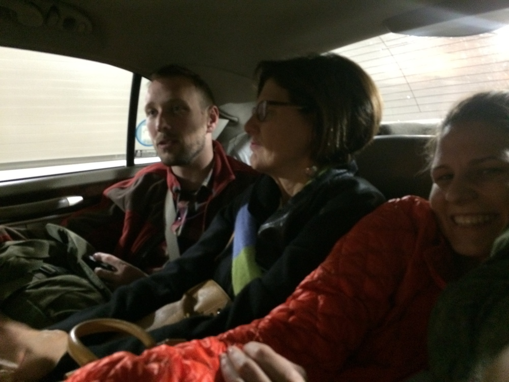Brian, Mom, Sam (not pictured) and me squished in the back of a taxi.