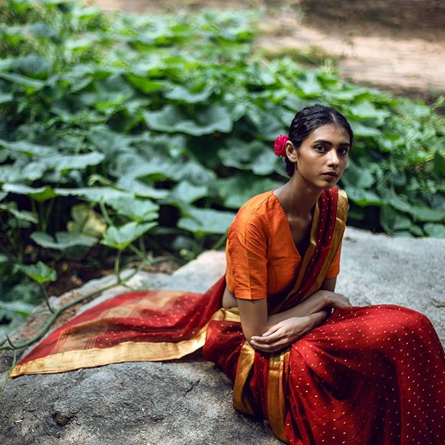 Perched . . . #viaeast #sari #ethnicwear #diwalishopping #festivecampaign #india #indianwear #traditionalwear #design #indiamodel #redsari #orangeblouse #georgette #flower #hairflower #portrait #indianmodel #indianfemale #photography #fineart #followphoto #photooftheday