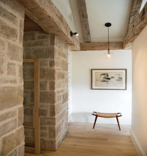 hallway stone detail by  Hutker Architects