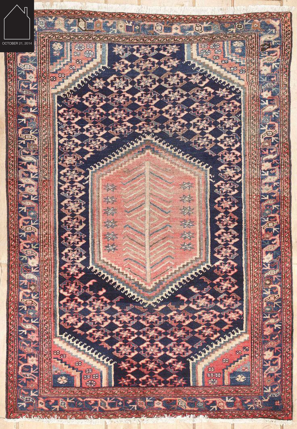 semi antique Persian rug via Medallion Rug