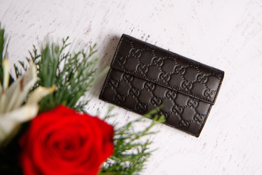 Gucci Wallet - Surprise Gift..I love it , not too flashy - the embossed G's and the dark leather are my speed. You can find it here or the larger version here