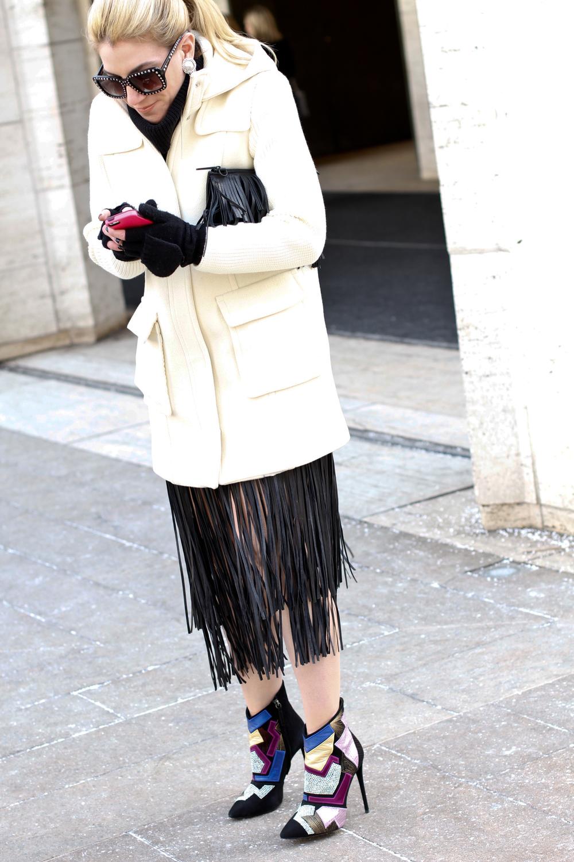 Fringe Clutch :  here // Leather Fringe Skirt : budget  BCBG or break the bank Tara Mellon // Studded Sunglasses :  PRADA