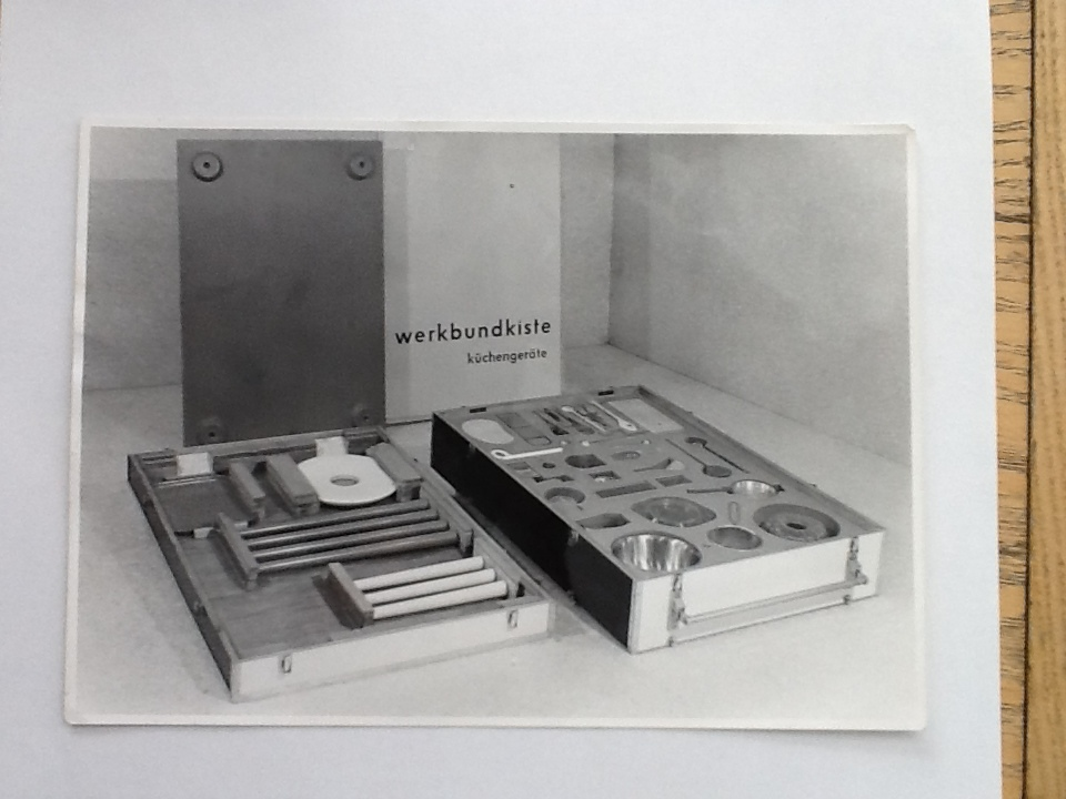 "Fig. 1  ""Hauptschulamt, Werkbundkiste,, Küchengeräte"" (Werkbund Crate 'Kitchen Tools') photograph by  Willi Nitschke, ca. 1955 (Landesarchiv Berlin oder LAB/ Willi Nitschke, F Rep. 290, Nr. 37469)                                  Normal     0                     false     false     false         DE     JA     X-NONE                                                                                                                                                                                                                                                                                                                                                                                                                                                                                                                                                                                                                                                                                                               /* Style Definitions */ table.MsoNormalTable 	{mso-style-name:""Table Normal""; 	mso-tstyle-rowband-size:0; 	mso-tstyle-colband-size:0; 	mso-style-noshow:yes; 	mso-style-priority:99; 	mso-style-parent:""""; 	mso-padding-alt:0in 5.4pt 0in 5.4pt; 	mso-para-margin-top:0in; 	mso-para-margin-right:0in; 	mso-para-margin-bottom:10.0pt; 	mso-para-margin-left:0in; 	mso-pagination:widow-orphan; 	font-size:12.0pt; 	font-family:Cambria; 	mso-ascii-font-family:Cambria; 	mso-ascii-theme-font:minor-latin; 	mso-hansi-font-family:Cambria; 	mso-hansi-theme-font:minor-latin; 	mso-ansi-language:DE;}"
