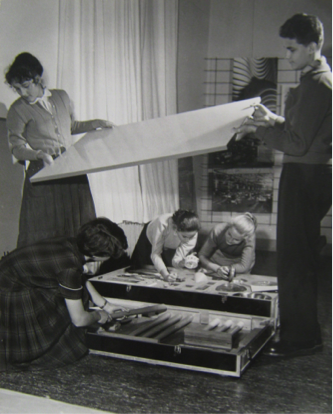"Fig. 5 Young Berliner students assembling the kitchen utensil crate. Publicity photograph by Bildbericht Orgel Köhne Berlin. Courtesy Werkbund Archiv/Museum der Dinge, Berlin.                                  Normal     0                     false     false     false         DE     JA     X-NONE                                                                                                                                                                                                                                                                                                                                                                                                                                                                                                                                                                                                                                                                                                               /* Style Definitions */ table.MsoNormalTable 	{mso-style-name:""Table Normal""; 	mso-tstyle-rowband-size:0; 	mso-tstyle-colband-size:0; 	mso-style-noshow:yes; 	mso-style-priority:99; 	mso-style-parent:""""; 	mso-padding-alt:0in 5.4pt 0in 5.4pt; 	mso-para-margin-top:0in; 	mso-para-margin-right:0in; 	mso-para-margin-bottom:10.0pt; 	mso-para-margin-left:0in; 	mso-pagination:widow-orphan; 	font-size:12.0pt; 	font-family:Cambria; 	mso-ascii-font-family:Cambria; 	mso-ascii-theme-font:minor-latin; 	mso-hansi-font-family:Cambria; 	mso-hansi-theme-font:minor-latin; 	mso-ansi-language:DE;}"