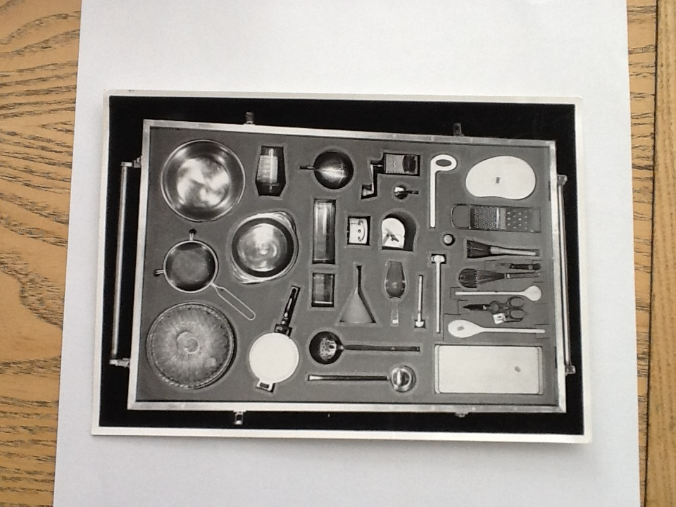 "Fig. 6 An image of the Berliner Werkbund's kitchen Utensil crate taken from above by Willi Nitschke, ca. 1955. Landesarchiv Berlin oder LAB/ Willi Nitschke, F Rep. 290, Nr. 37471.                                  Normal     0                     false     false     false         DE     JA     X-NONE                                                                                                                                                                                                                                                                                                                                                                                                                                                                                                                                                                                                                                                                                                               /* Style Definitions */ table.MsoNormalTable 	{mso-style-name:""Table Normal""; 	mso-tstyle-rowband-size:0; 	mso-tstyle-colband-size:0; 	mso-style-noshow:yes; 	mso-style-priority:99; 	mso-style-parent:""""; 	mso-padding-alt:0in 5.4pt 0in 5.4pt; 	mso-para-margin-top:0in; 	mso-para-margin-right:0in; 	mso-para-margin-bottom:10.0pt; 	mso-para-margin-left:0in; 	mso-pagination:widow-orphan; 	font-size:12.0pt; 	font-family:Cambria; 	mso-ascii-font-family:Cambria; 	mso-ascii-theme-font:minor-latin; 	mso-hansi-font-family:Cambria; 	mso-hansi-theme-font:minor-latin; 	mso-ansi-language:DE;}"