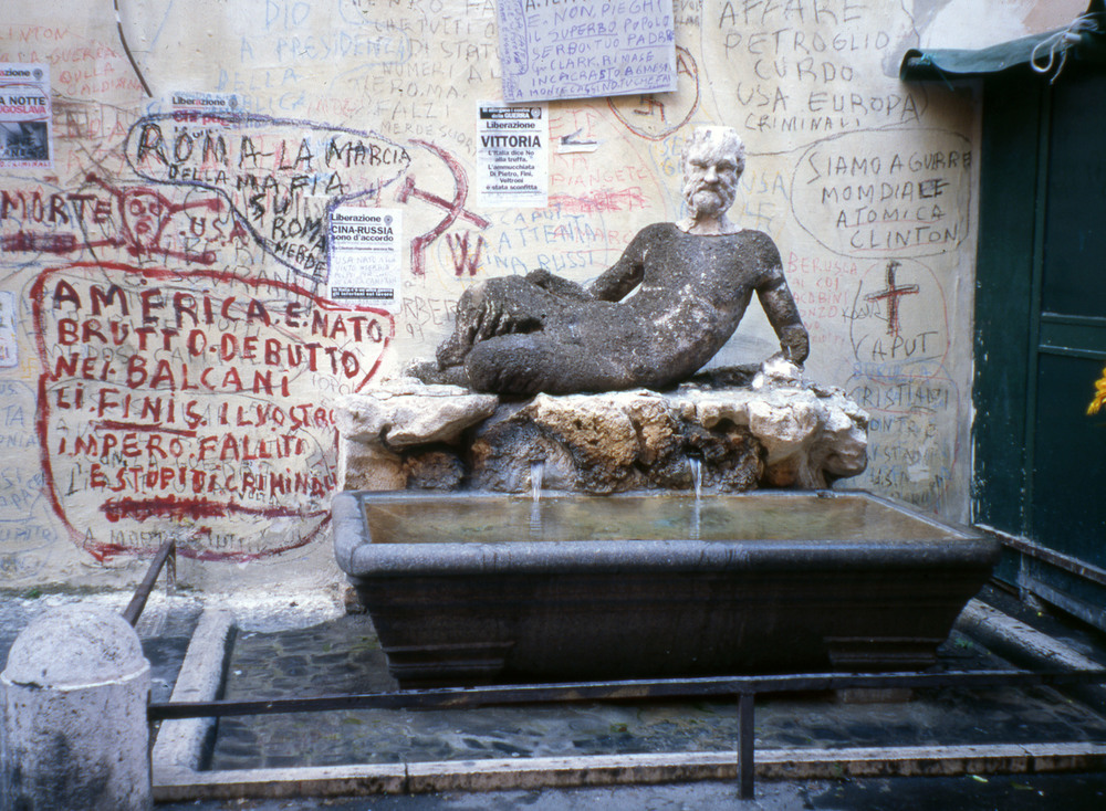 The Babuino, a public drinking fountain from the 1570s where Romans can still post anti-clerical and anti-government  pasquinades .