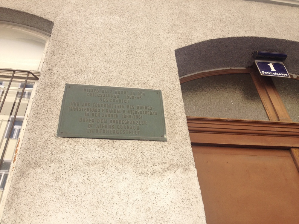 View of the plaque mounted at the entrance to the apartment building on Perinetgasse where the 1964 Mühl and Kren collaborations took place. In this commemorative gesture, the building is identified as part of the postwar rebuilding efforts undertaken by the Second Austrian Federal Republic. July 2014. Photo courtesy of Megan Hoetger.