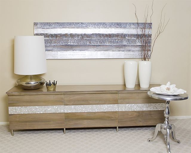 Danah means exquisite pearl, and our Danah is certainly exquisite. The intricate mother-of-pearl detail accentuates the beautiful rosewood body of this credenza. A subtle and yet powerful piece of furniture.