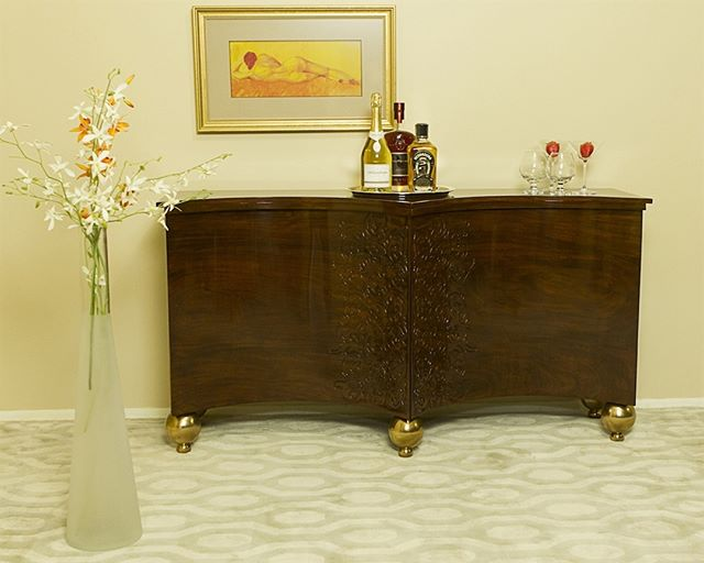 Delicate custom carving adorns this beautiful and exotic rosewood bar. Accented with fun and modern copper feet, this piece is the perfect for those special moments.