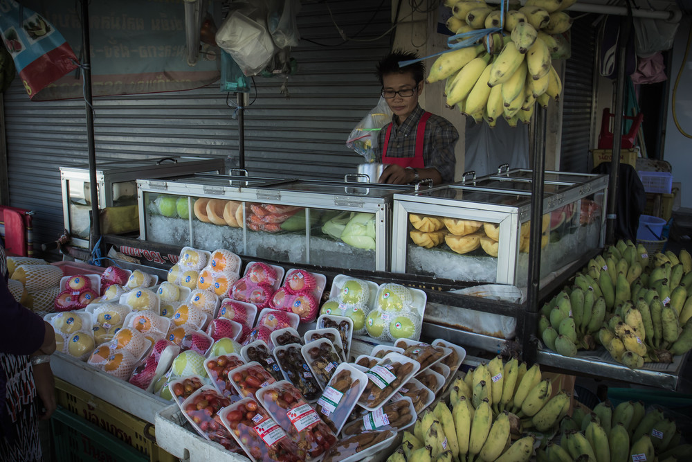 Stopping by the local Thai streetside fruitstand.