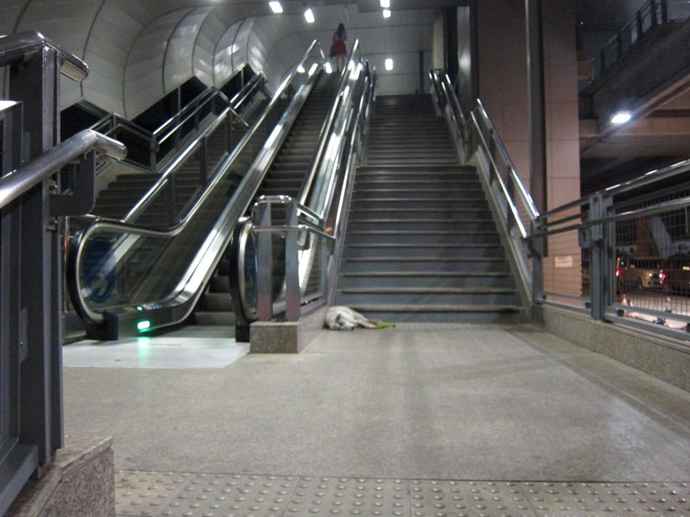 The dog at HuaMark Airport Link Station, everyday he's here, sleeping or hanging out.