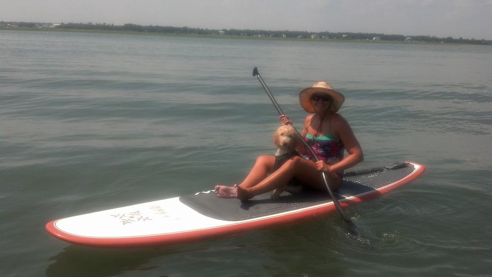 Bella, my goldendoodle, and I paddleboarding when she was just a baby about a year ago.