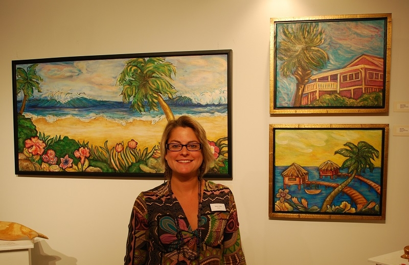 Dana with her artwork in the background on the Mega Yacht art venue SeaFair.