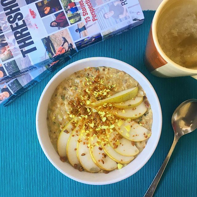 Big bowl of hot porridge on this rainy morning... featuring grated courgette, pear chunks and slices on top (pretty!) and a generous sprinkle of Lemon Pie #wholeplustoppers ...on the side you'll notice the new @thresholdstories book that I had the huge privilege of contributing my story to, my story dives into the time back in 2011-12 that changed my life forever.  Intrigued? You can find out more via the recent post on my main @johodson account and on my blog here: www.includingcake.com/thresholds