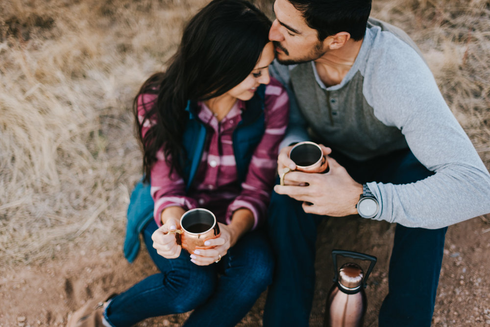 Evan and Angela brought spiked coffee to their engagement session at Red Rocks Park and Amphitheater. Here we are taking a small coffee break - thankfully it was February and it wasn't terribly cold!