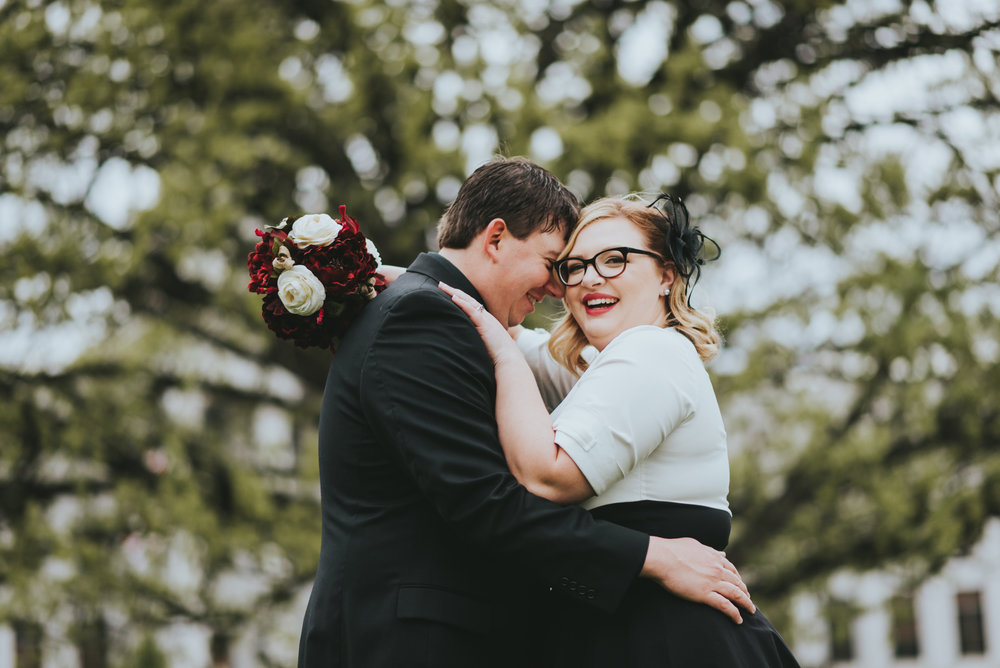 Jessamyn and Colby took a walk in front of the Denver County Courthouse after their elopement. They drove from Nebraska to elope in Denver, and were going to mini-moon for a few days after the ceremony.