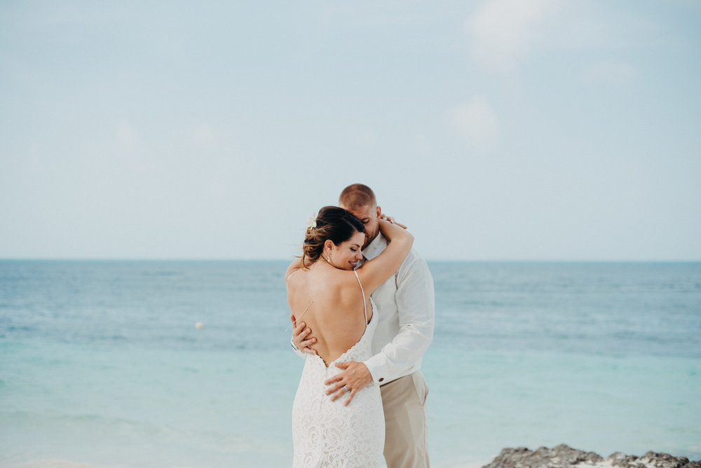 Julia and Tony, enjoying their newly married bliss on the beautiful beach in Cancun, Mexico. They decided to have a destination elopement to Cancun Mexico, and I couldn't have been more happy to have been hired as their wedding photographer.
