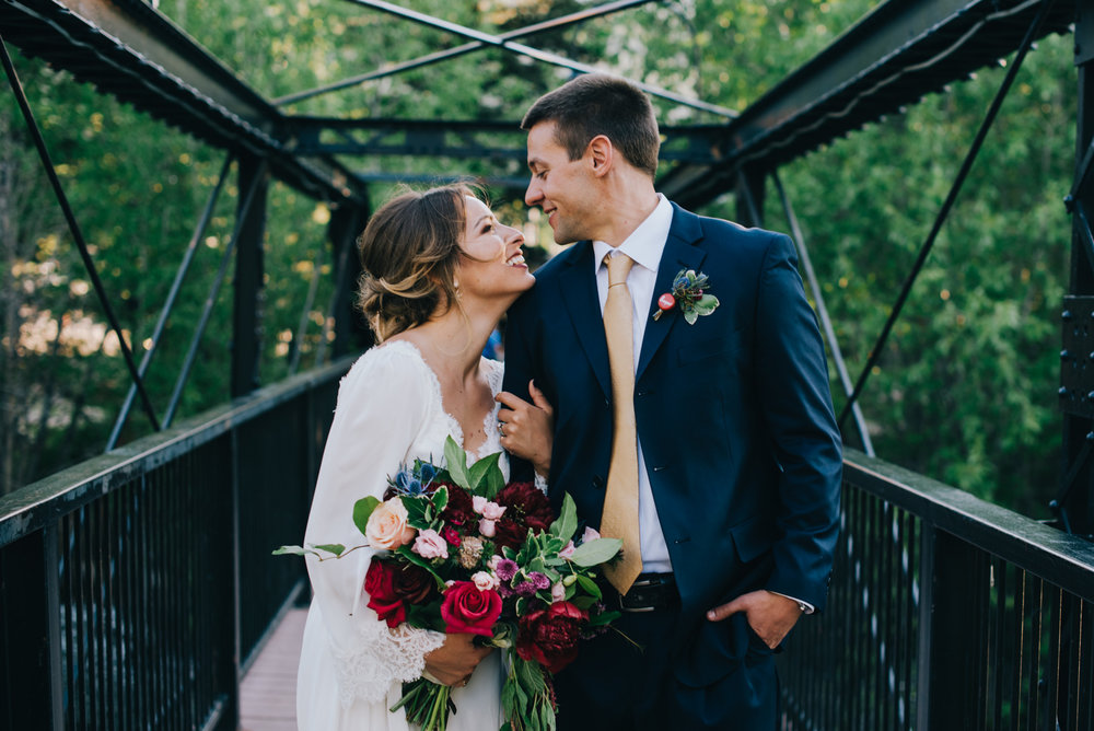 I love Chelsea's flowers in this bridge shot right outside the Silverthorne Pavilion in Silverthorne, Colorado. This wedding venue is a gem, and I love this bridge that's right outside of it.
