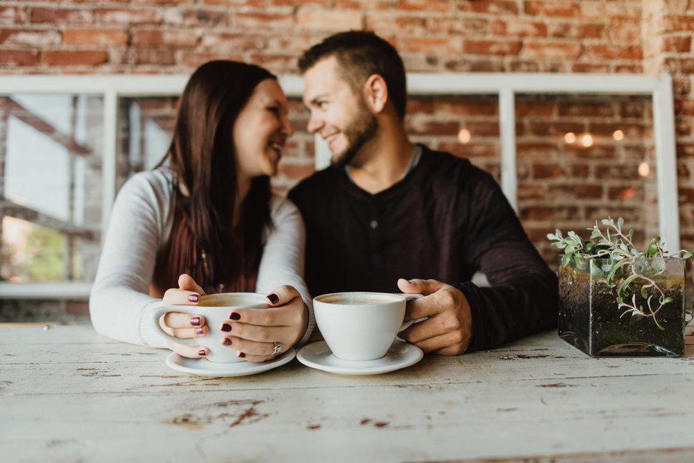 Lynsey & Chris enjoying each others company before enjoying their lattes. I love when couples are comfortable and having fun during their engagement sessions. They engagement session was done in Denver, at Black Eyed Coffee in the Highlands. Copyright: Teresa Woodhull Photography