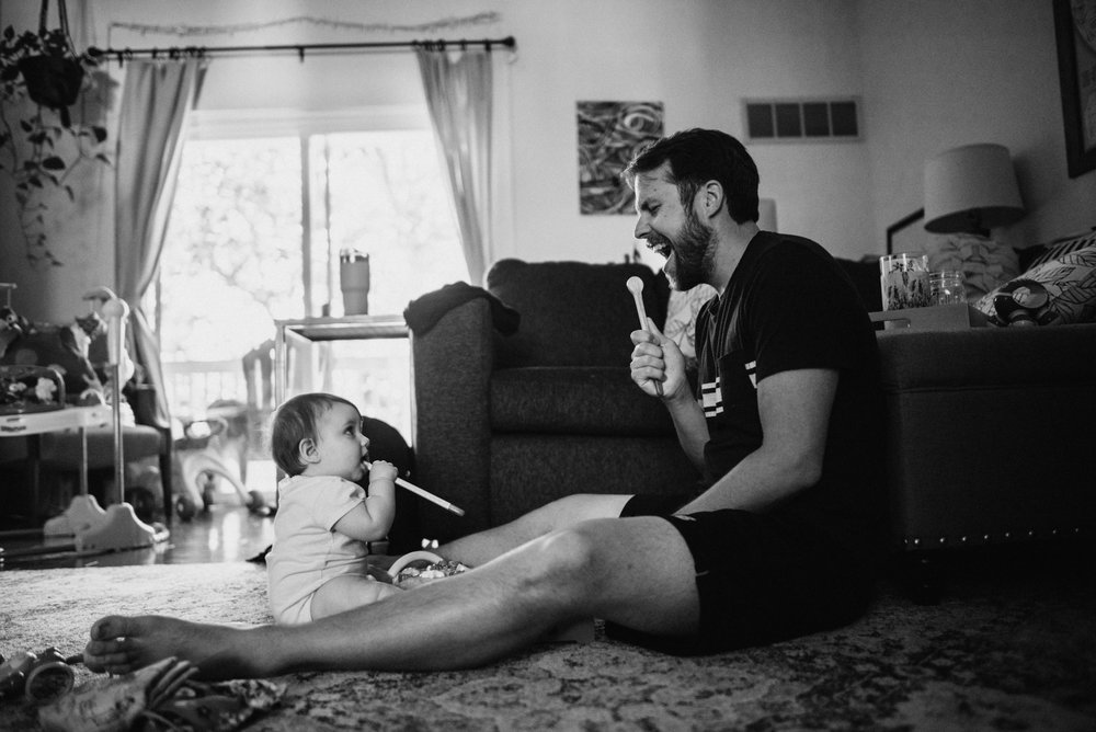 This is my daughter Luna, and my husband Woody, making music together. Nothing makes me happier then little moments such as these. They are two peas in a pod, this father daughter duo/ I love how Luna is copying Woody and pretending the drumstick is also a microphone. I throughly enjoy lifestyle family sessions such as these. Copyright: Teresa Woodhull Lifestyle and Family Photography.