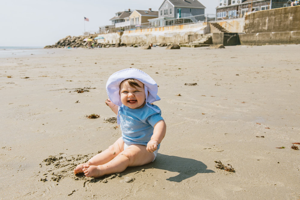 This is my daughter Luna on her second beach trip in Maine. She was loving the sand, and was very into eating it as well!