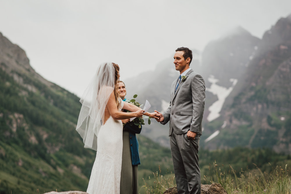 In August I had the please of capturing this beautiful mountain destination elopement in the Maroon Bells. The weather was foggy and stormy, but they were more then willing to go trekking through the mud for some awesome Maroon Bells Elopement Photos. The Bells are right outside of Aspen, so right after the elopement they met their families in town for a reception!
